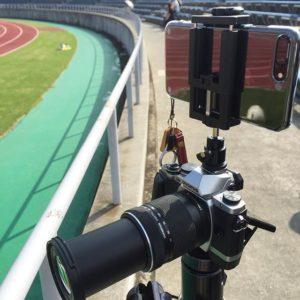 本日の撮影スタイル。三脚に望遠レンズつけたミラーレス一眼で連写、その上のホットシューにiPhone7+くっつけて4K動画撮影。我ながらおバカスタイルだわww|Instagram